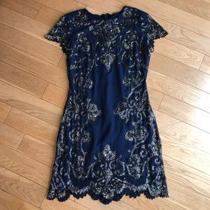Mini dress with embellished detailing